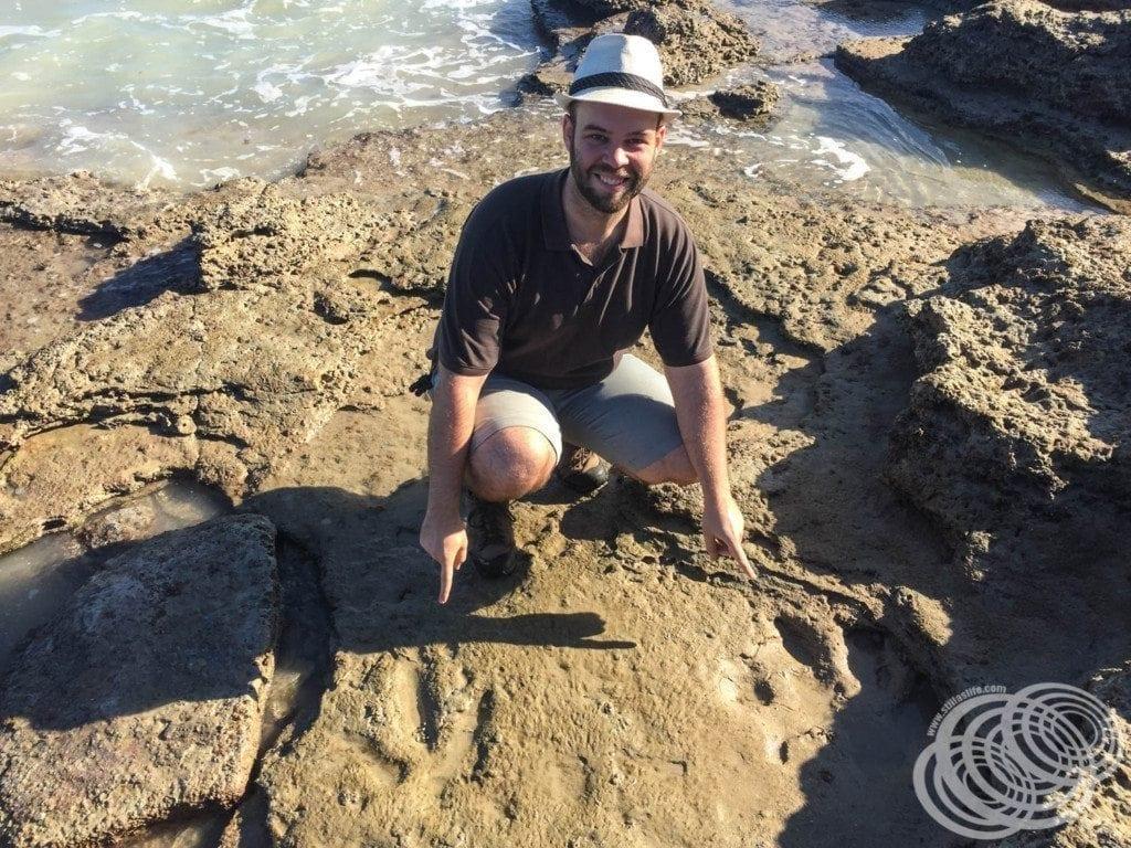 Matt with Dinosaur Footprints at Gantheaume Point, Broome in Western Australia.