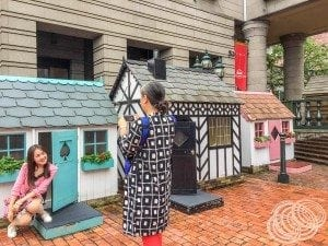 Some ladies having fun in tiny houses at the entry to Shiroi Koibito Park