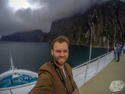Matt at Milford Sound with Stirling Falls in the Background
